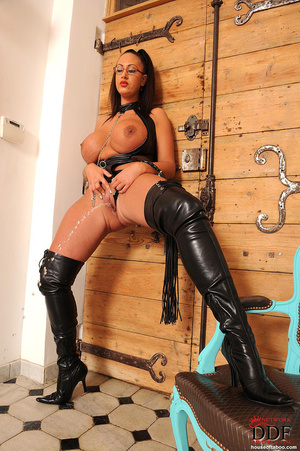 Very big boobed dom in leather thong and over the knee boots plays with a large black dildo and fucks herself with it in her ass and tits - XXXonXXX - Pic 10