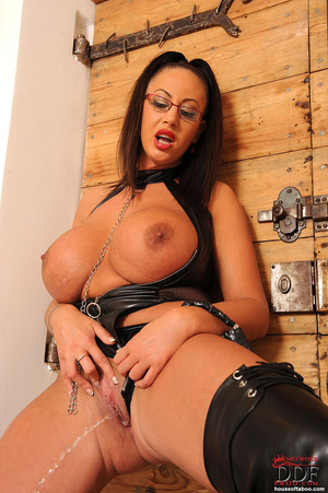 Very big boobed dom in leather thong and over the knee boots plays with a large black dildo and fucks herself with it in her ass and tits - XXXonXXX - Pic 11