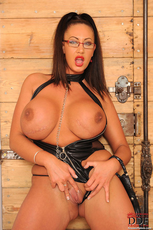 Very big boobed dom in leather thong and over the knee boots plays with a large black dildo and fucks herself with it in her ass and tits - XXXonXXX - Pic 12