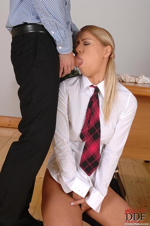 Gagged with her panties, a naughty coed slut is made to suck the male teacher's stiff cock then made to piss into a container which the teacher holds up - XXXonXXX - Pic 4