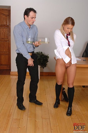 Gagged with her panties, a naughty coed slut is made to suck the male teacher's stiff cock then made to piss into a container which the teacher holds up - XXXonXXX - Pic 16