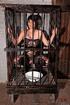 Short haired brunette slave wearing a fishnet body…