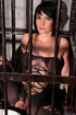Short haired brunette slave wearing a fishnet body…