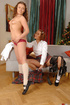Merciless female dom puts on a body harness onto a…