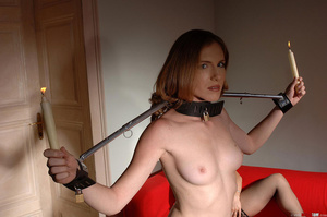 Busty dom fucks herself with a large dildo while watching restained sub bound in spreader bars whilst holding candles take a piss on herself - XXXonXXX - Pic 3