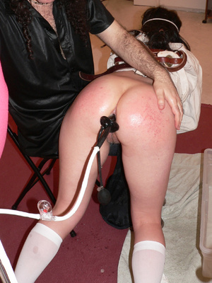 Brunette school girl in checked skirt and long socks punished before taking an enema - XXXonXXX - Pic 2