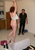 Ginger teen in hand cuffs suspended to the ceiling caned violently