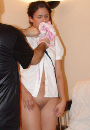 Ponytailed brunette teen getting her mouth stuffed with her own panties - XXXonXXX - Pic 1