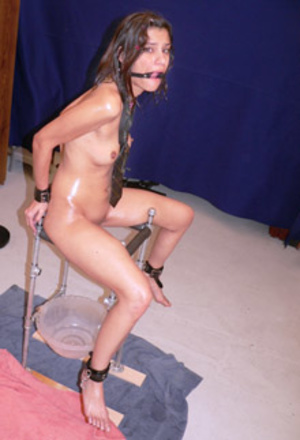 Long-haired teen chick with a mouth gag bound to a chair waiting her turn - XXXonXXX - Pic 1