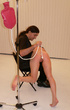 Brunette teen chick bound and suspended on a sling…