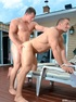 Two beefy guys check out not only each other's pecs and biceps but also