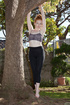 Pretty teen gymnast girl with red hair exercising…