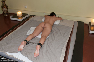 Lana laying on the bed face down with he - XXX Dessert - Picture 2