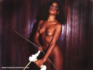Very hot exotic beauty with roped hands surrounded by her tribe weapons - Picture 7