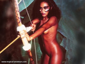 Very hot exotic beauty with roped hands surrounded by her tribe weapons - Picture 8