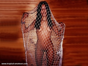 Slim tropical gal with dreads posing nude in cuffs and fishnet - XXXonXXX - Pic 1