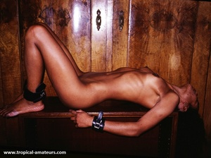 Slim tropical gal with dreads posing nude in cuffs and fishnet - XXXonXXX - Pic 4