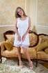 Likable babe on counch removes white dress to get…