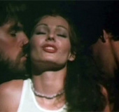 Annette Haven giving double handjob to 2 male…