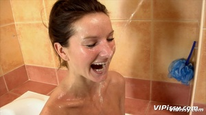 Babe in bath washes herself with hot piss before being sprayed by guy with piss - XXXonXXX - Pic 12