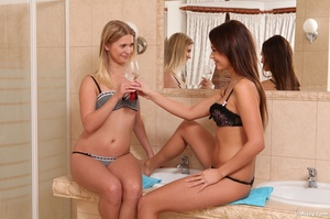 Two cute babes in bathroom piss on each other, kiss and drink piss - XXXonXXX - Pic 1