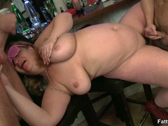 Fat babe in glasses and hat sucks cock as another guy - Picture 16