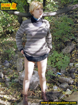 Cute short hair blonde bends down to take a piss out in the woods in early autumn - XXXonXXX - Pic 1