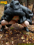 Shy teen wrapped up in a hooded black coat bends…