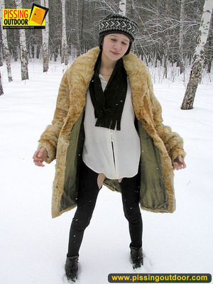 Cute white teen in fur coat, shirt and pantyhose takes an piss in the snow - XXXonXXX - Pic 1
