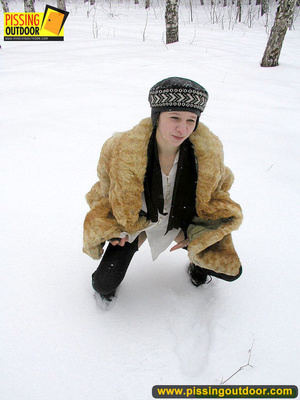Cute white teen in fur coat, shirt and pantyhose takes an piss in the snow - XXXonXXX - Pic 4