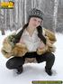 Cute white teen in fur coat, shirt and pantyhose…