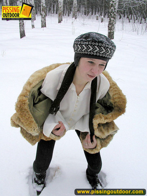 Cute white teen in fur coat, shirt and pantyhose takes an piss in the snow - XXXonXXX - Pic 15