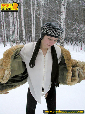 Cute white teen in fur coat, shirt and pantyhose takes an piss in the snow - XXXonXXX - Pic 16