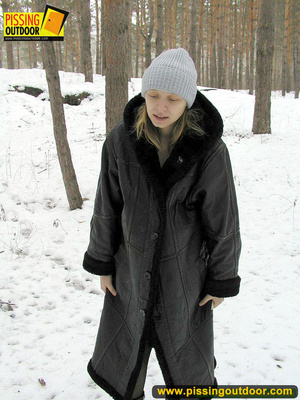 Pregnant young teen in jacket and pantyhose releases a stream of piss in the snow - XXXonXXX - Pic 1