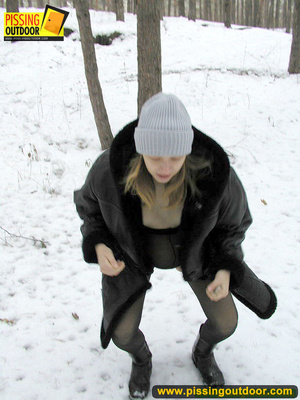 Pregnant young teen in jacket and pantyhose releases a stream of piss in the snow - XXXonXXX - Pic 3