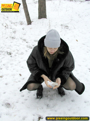 Pregnant young teen in jacket and pantyhose releases a stream of piss in the snow - XXXonXXX - Pic 4