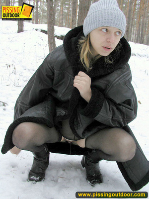 Pregnant young teen in jacket and pantyhose releases a stream of piss in the snow - XXXonXXX - Pic 18