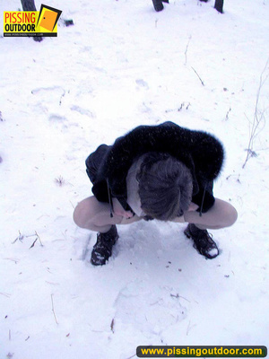 Kinky teen in glass bends to piss in the snow revealing tits and cute bushy pussy - XXXonXXX - Pic 4
