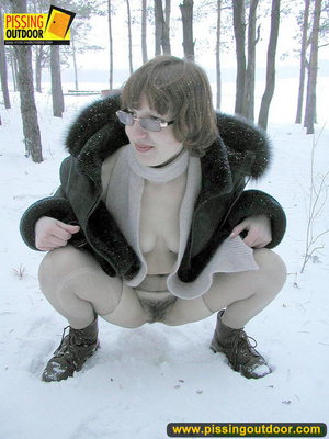 Kinky teen in glass bends to piss in the snow revealing tits and cute bushy pussy - XXXonXXX - Pic 11