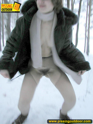 Kinky teen in glass bends to piss in the snow revealing tits and cute bushy pussy - XXXonXXX - Pic 13