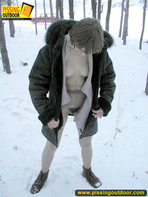 Kinky teen in glass bends to piss in the snow revealing tits and cute bushy pussy - XXXonXXX - Pic 15