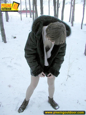 Kinky teen in glass bends to piss in the snow revealing tits and cute bushy pussy - XXXonXXX - Pic 17