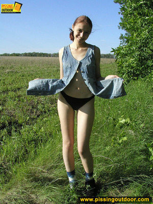 Young chick removes panties and stands pissing outdoors before tasting her cunt - XXXonXXX - Pic 18