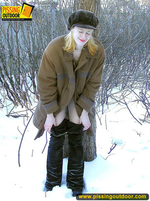 Blonde teen wearing only a coat in winter opens it to stand pissing on the snow - XXXonXXX - Pic 5