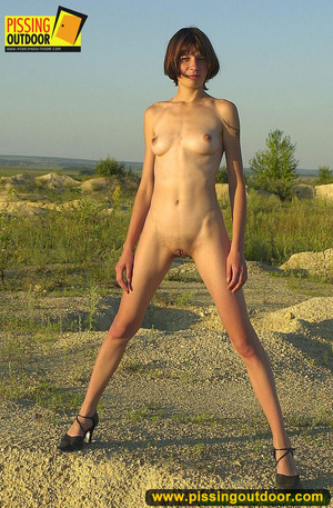 Nude brunette with slim sexy shape opens up pussy lips to stand pissing outdoors - XXXonXXX - Pic 3