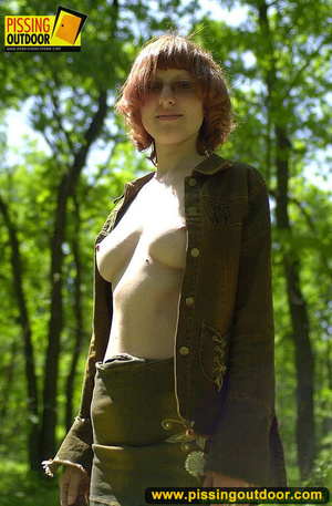 Cute red head in glasses gets nude and sits down on grasses to jet out hot piss - XXXonXXX - Pic 1
