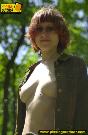 Cute red head in glasses gets nude and sits down on grasses to jet out hot piss - XXXonXXX - Pic 2