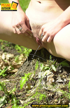 Cute red head in glasses gets nude and sits down on grasses to jet out hot piss - XXXonXXX - Pic 15