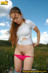 Hot chick strips jeans to show sweet pink panties…