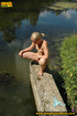 Sexy blonde with hot booty climbs concrete ledge…